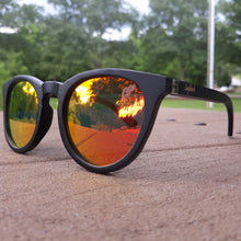 Load image into Gallery viewer, sunset mirror sunglasses with black wood arms outdoors