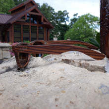 Load image into Gallery viewer, zebrawood full frame sunglasses side view on rock