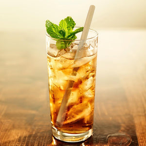 Bamboo straw in an iced drink