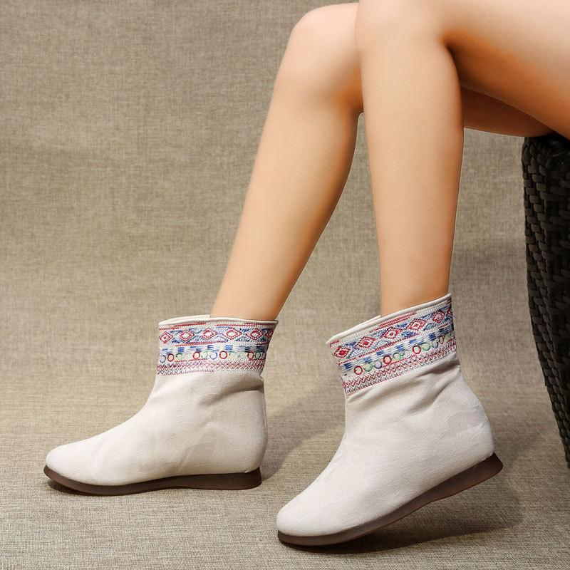 National wind embroidered wedge heel boots