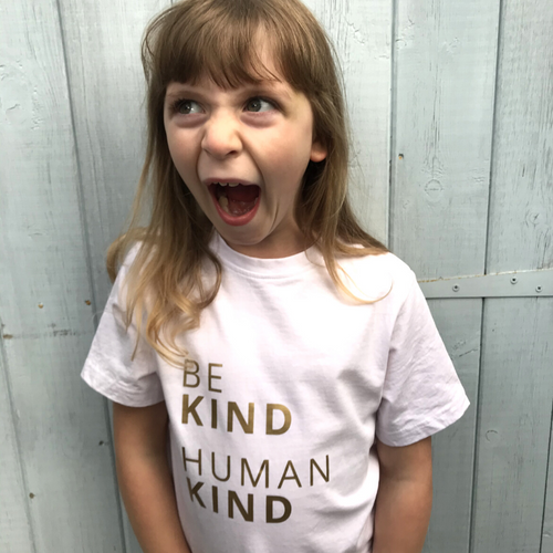 BE KIND HUMAN KIND Organic Statement T-Shirt For Children: Watery Pink With Gold Font Design