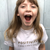 POSITIVITY Statement T-Shirt For Children: Watery Pink With Gold Font Design