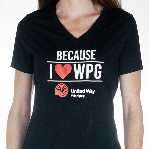 "Black v-neck t-shirt featuring ""Because I Love Wpg"" on it in white block lettering with a red heart and a red and white United Way Winnipeg logo."
