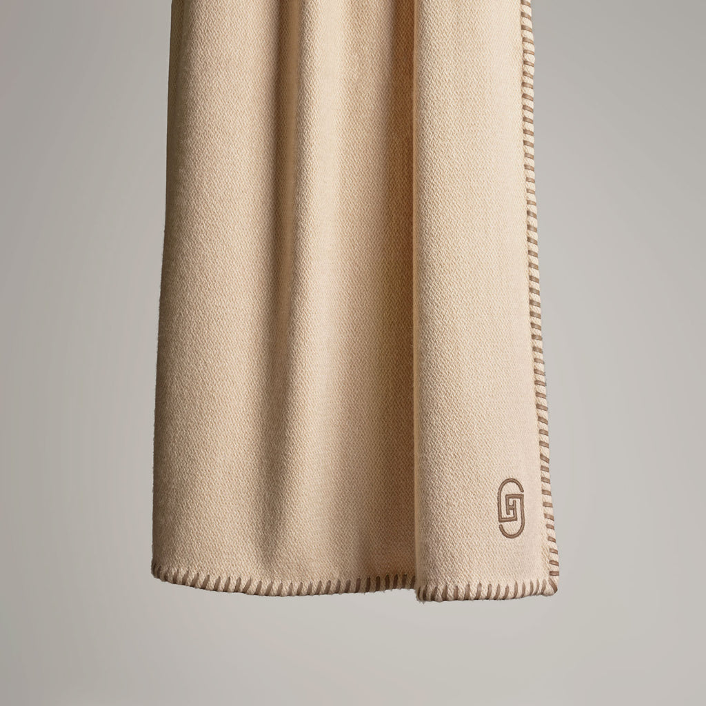 CASHMERE THROW WITH LEATHER DETAIL · SAND