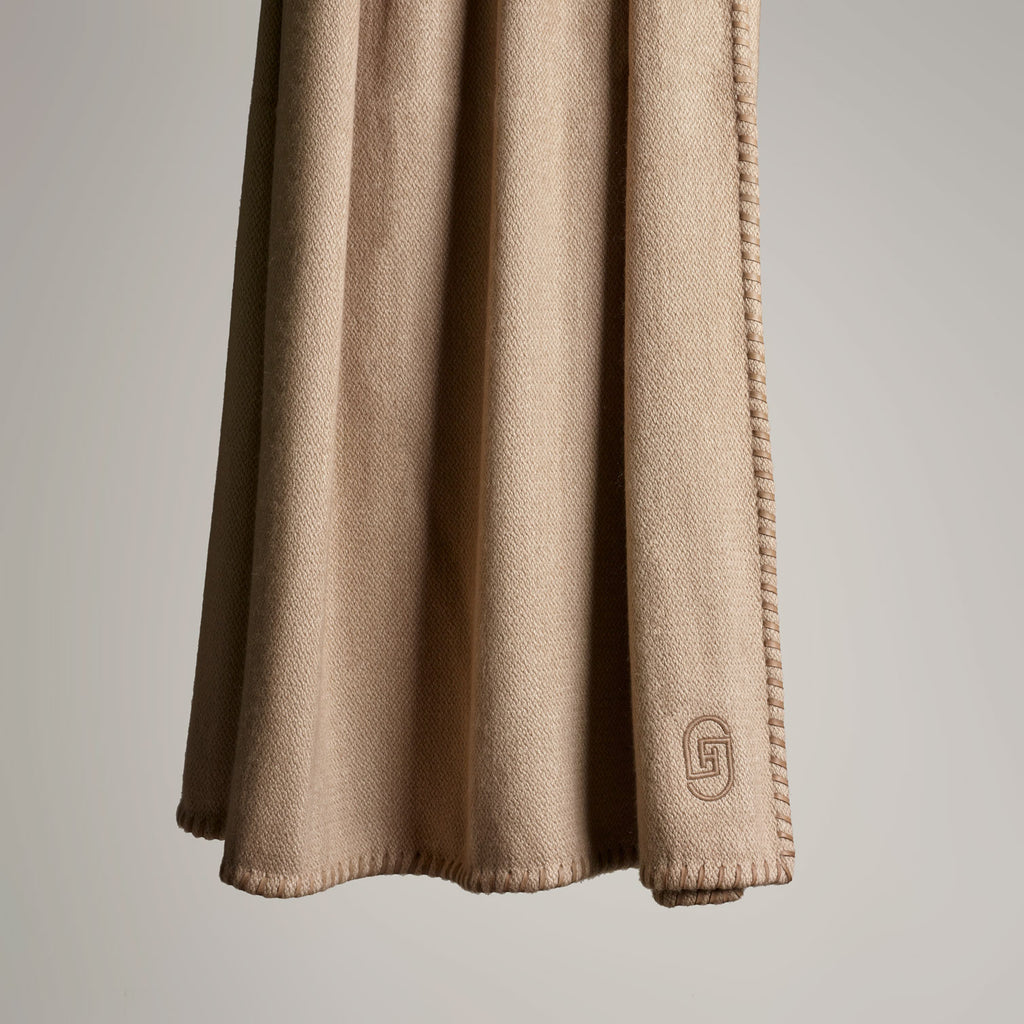 CASHMERE THROW WITH LEATHER DETAIL · TAUPE