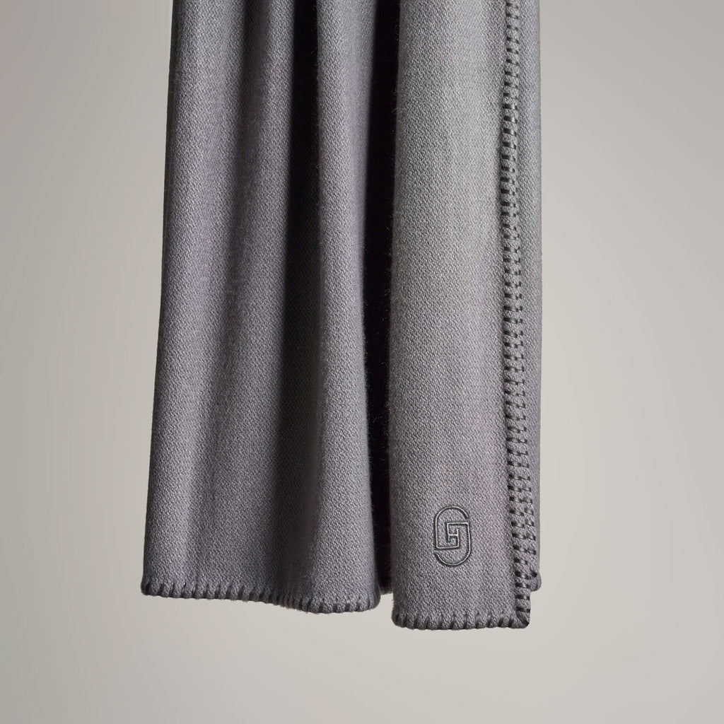 CASHMERE THROW WITH LEATHER DETAIL · STONE