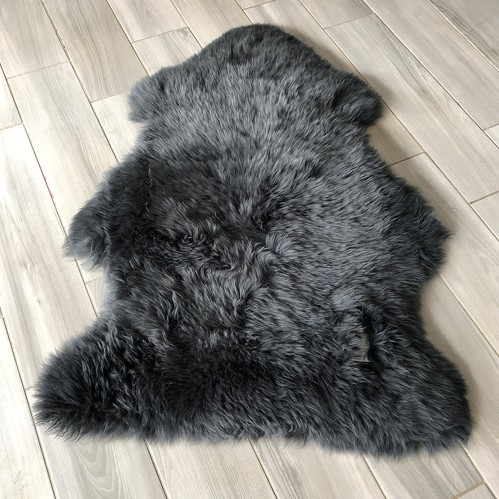Bettys Barn Interiors - Charcoal Sheepskin Rug shown on wooden floor