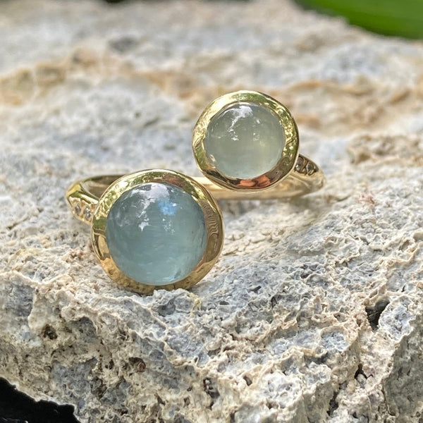 Styled shot of aquamarine stone ring in 14k yellow gold.