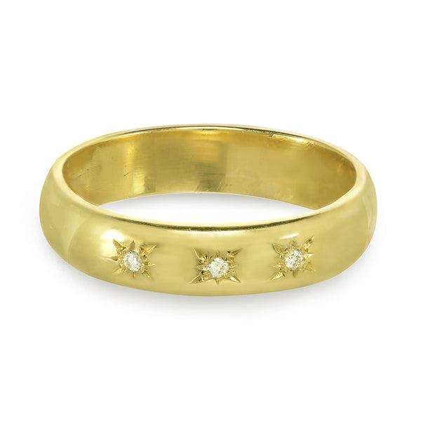 Men or women's gold wedding band with three diamonds on the front.