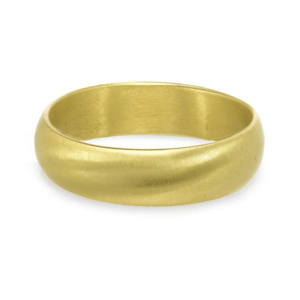 Men or women's gold wedding band with a matte finish.