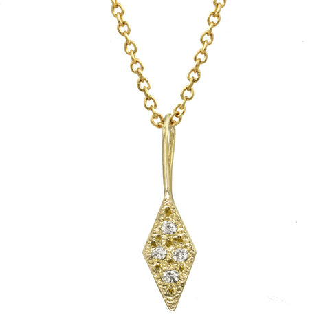 Trapezoid diamond pendant with bezel diamonds on a gold chain necklace.