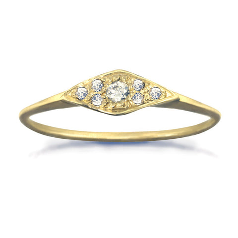 Horizontal geometric ring with small white diamonds in gold.