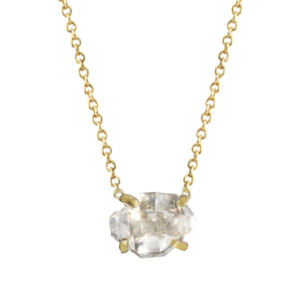 Delicate Herkimer Crystal pendant necklace with a gold chain.