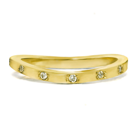 Gold ring with bezeled diamonds. Perfect for a wedding ring.