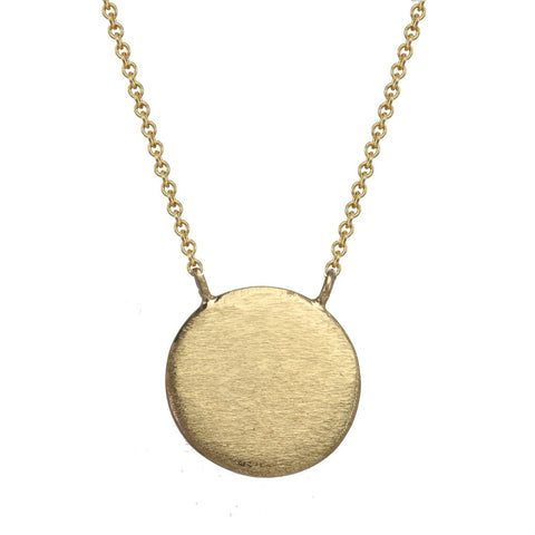 Large gold circle necklace.