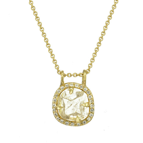 Diamond slice pendant necklace with gold chain.