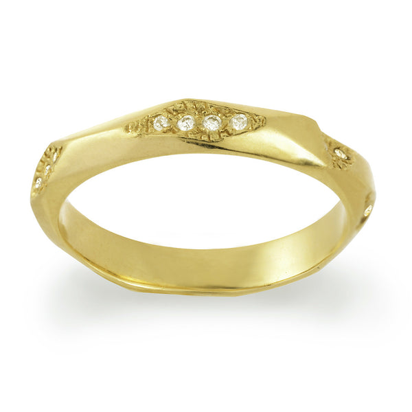 Plain gold textured wedding band for men and women with small diamonds.