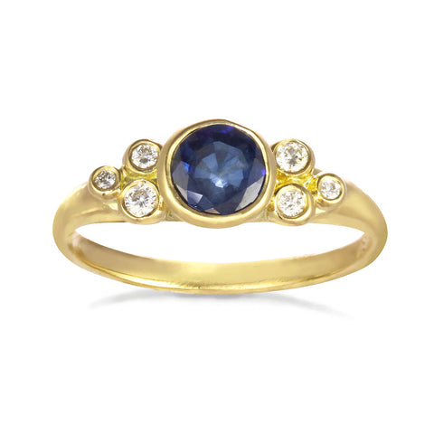 Constellation Ring with a morganite or sapphire center stone. Six small diamonds on the side.