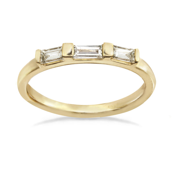 Three rectangle baguette diamonds on a 14k gold band