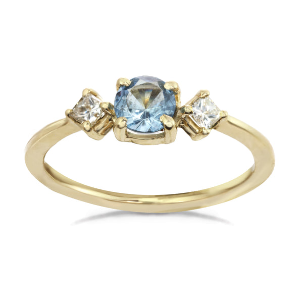 14 karat gold ring with sky blue center aquamarine stone and two diamonds