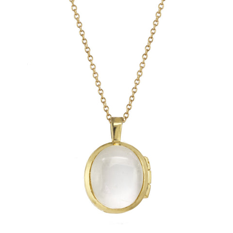 Gold locket with a Herkimer crystal on a gold chain.