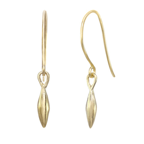 "Dangling gold hook earrings with small ""seed"" shapes."