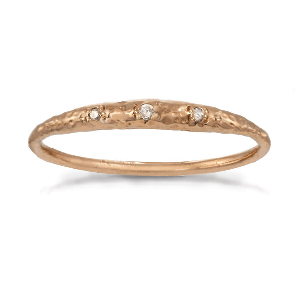 Thin rose gold band with tiny crescent shaped diamonds in the front.