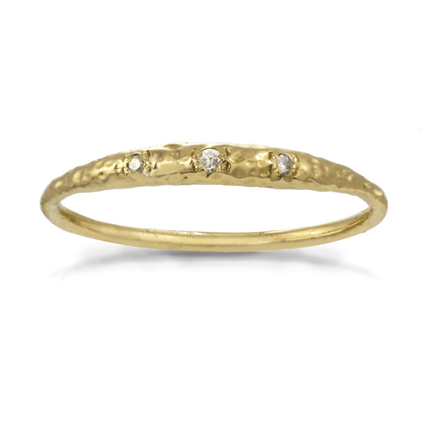 Thin gold band with a diamond crescent moon shape in front.