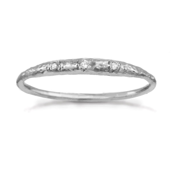 Thin sterling silver band with tiny crescent shaped diamonds in the front.