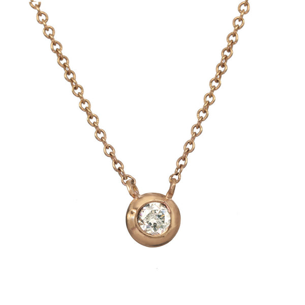 Rose gold pendant necklace with a white or champagne diamond.
