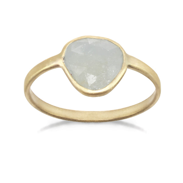 Gold ring with a large sapphire center stone.