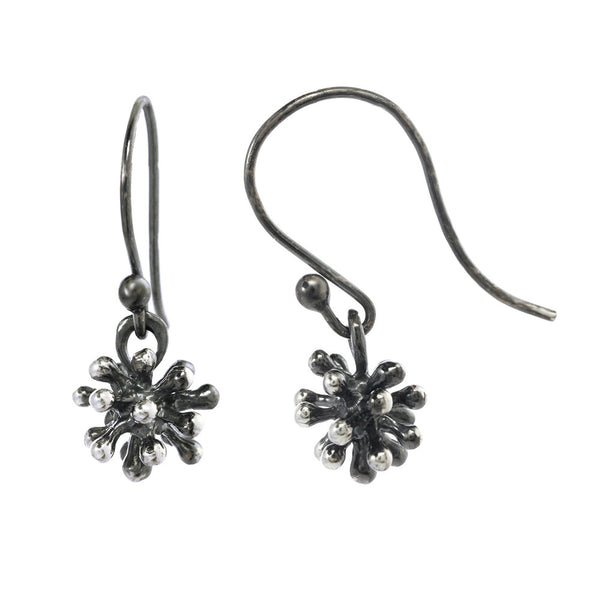 Dangling dandelion earrings on an oxidized silver fishhook.