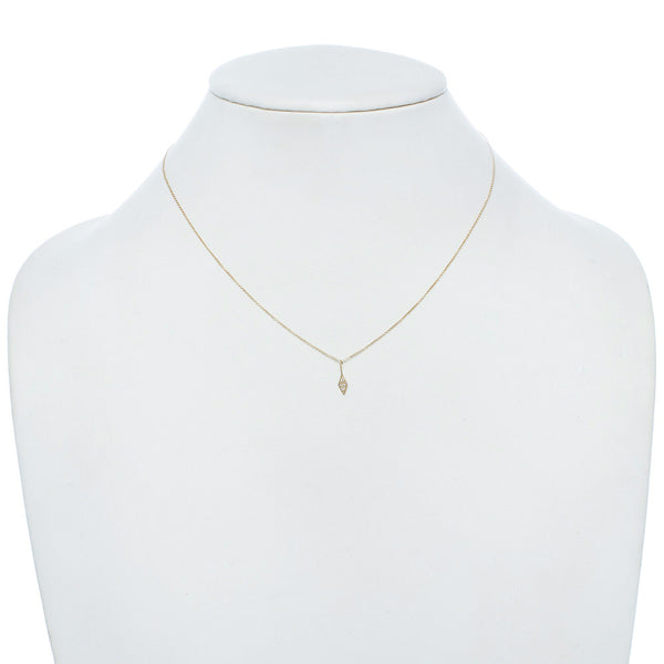 Diamond geometric necklace on a gold chain