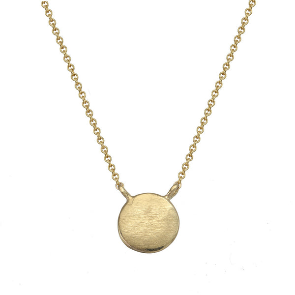 Small gold circle necklace.