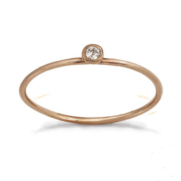Delicate rose gold ring with center white diamond stone.