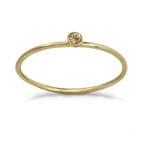 Delicate gold ring with champagne diamond stone.