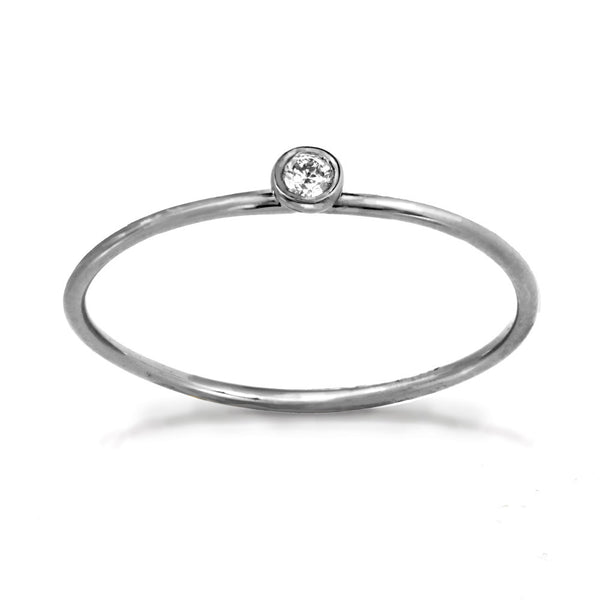 Delicate white gold ring with center white diamond stone.
