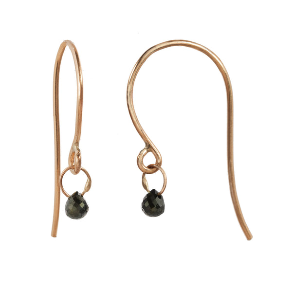 Tiny Constellation drop earring with small black diamond on a rose gold fishhook.