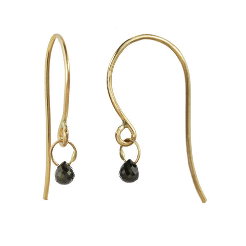 Tiny Constellation drop earring with small black diamond on a yellow gold fishhook.