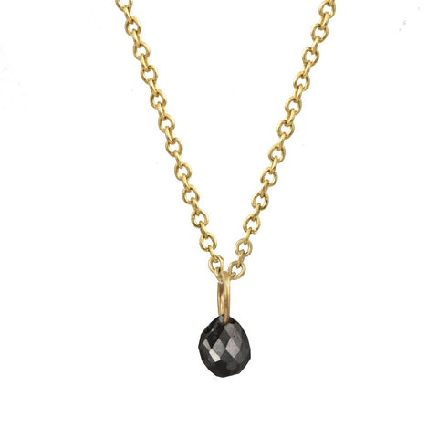 Tiny Constellation drop necklace with small black diamond on a gold chain.