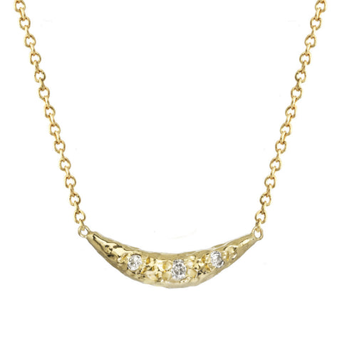 Crescent moon half moon pendant necklace with white diamonds on a yellow gold chain.