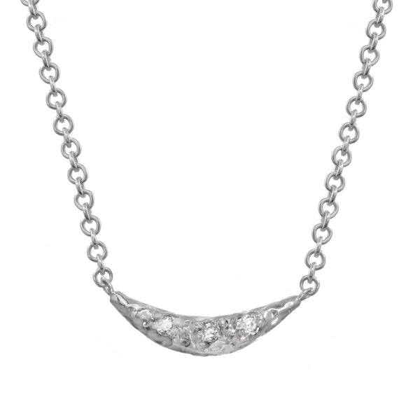 Crescent moon half moon pendant necklace with white diamonds on a sterling silver chain.