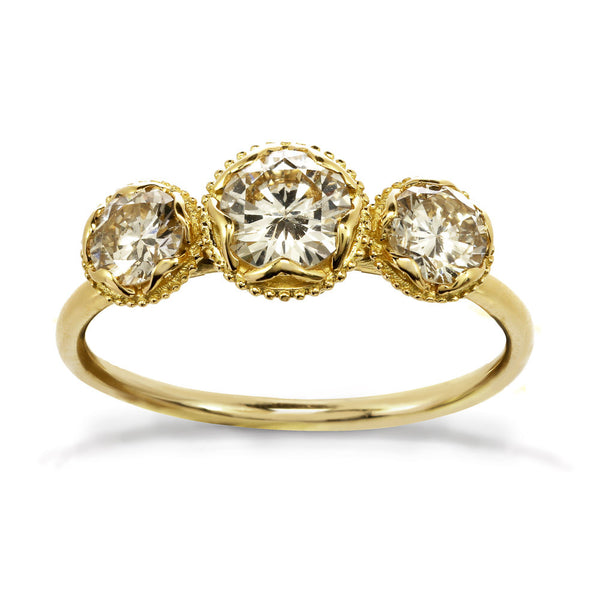 Gold engagement ring with three champagne diamonds