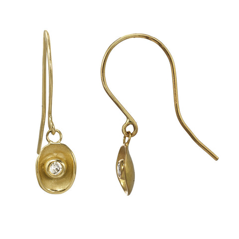 Waterlily inspired dangling gold earrings with a gold fishhook.