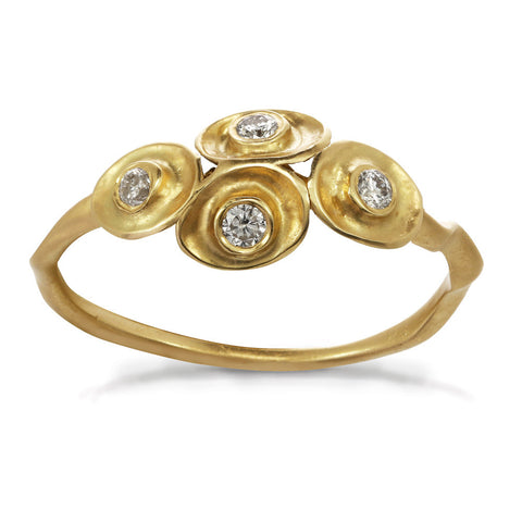 Waterlily inspired gold ring with four diamonds.