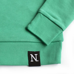 The Number 3 green sweatshirt detail