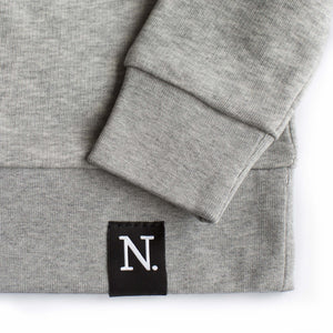 The Number 3 grey sweatshirt detail
