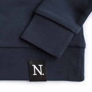 The Number 5 navy sweatshirt detail