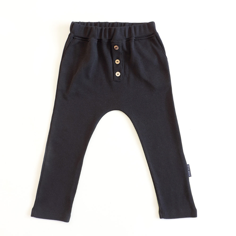 BUTTON PANTS IN BLACK PIQUE