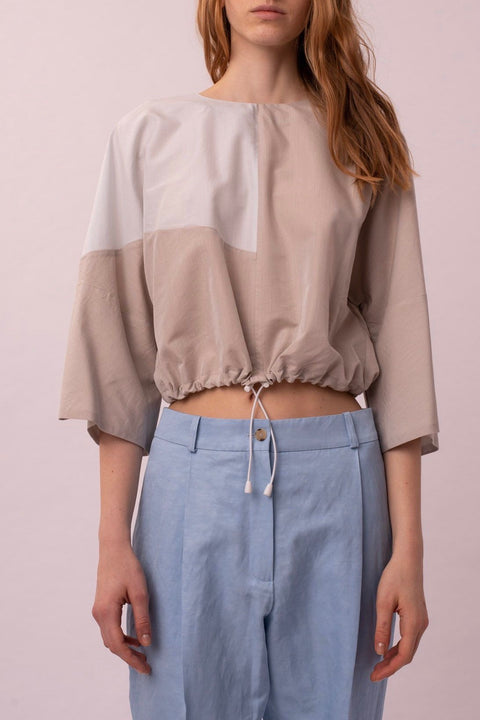 Blue cropped color block blouse
